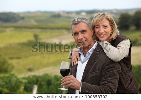 Zdjęcia stock: Couple With Wine Glass In Front Of Vineyard