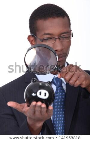Fekete jólöltözött férfi néz persely nagyító Stock fotó © photography33