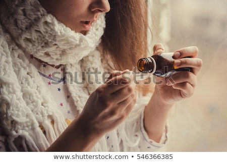 Woman taking cough medicine Stock photo © photography33
