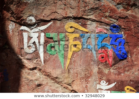 Tibetan prayer flags and mani rocks Stock photo © bbbar