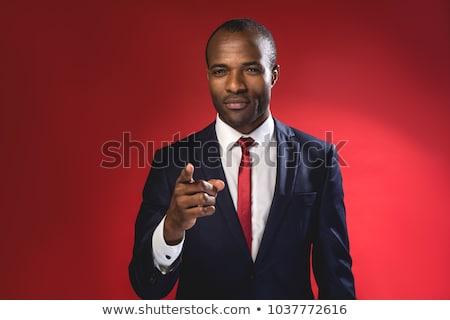 молодые · деловой · человек · указывая · портрет · лице · человека - Сток-фото © feedough