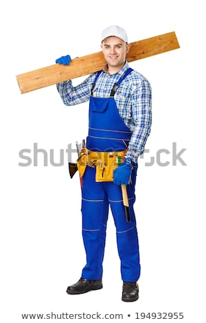 portrait of young joiner carrying planks over shoulder Stock photo © photography33
