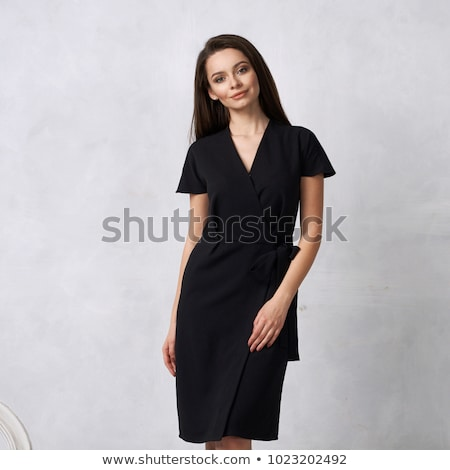 Smiling Brunette woman with long magnificent hair in black dress Stock photo © Victoria_Andreas