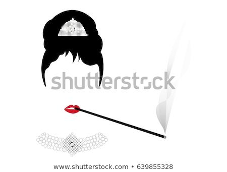 Portrait of a brunette with cigarette holder Stock photo © acidgrey