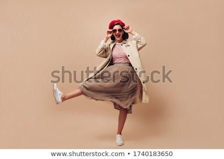 Atraente vermelho menina trincheira casaco Foto stock © feverpitch