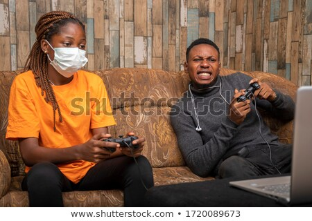Young couple competing with laptops Stock photo © photography33