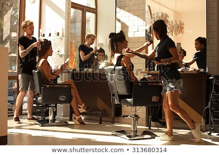 Working Hairstylist Curling Hair in a Salon Stock photo © tobkatrina