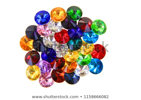 Colored gems isolated on light blue background Stock photo © arlatis