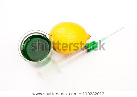 Beakers next to lemons against a white background Stock photo © wavebreak_media