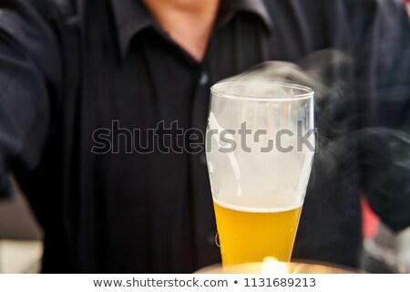 Beer drinker lighting up a cigarette Stock photo © stevanovicigor