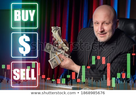 businessman with a speculative expression stock photo © smithore
