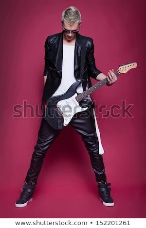 guitar rock star man sunglasses leather jacket stock photo © lunamarina