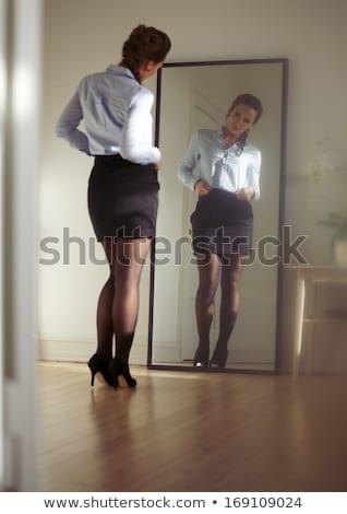 Checking herself in the mirror stock photo © javiercorrea15
