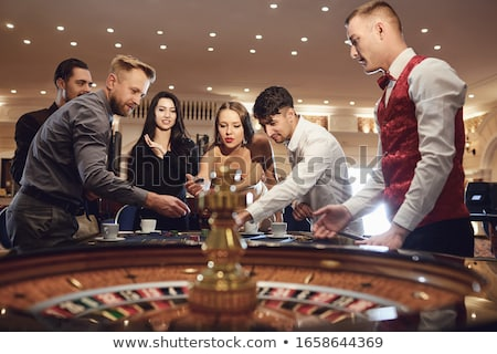Woman in casino playing cards Stock photo © Elnur