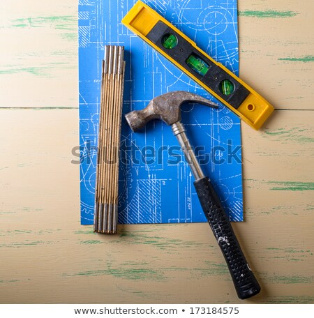 hammer with lostock and folding rule over a blueprint och a wood stock photo © phila54