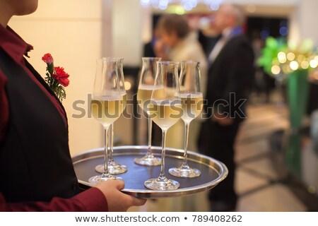feliz · jovem · garçom · vidro · champanhe - foto stock © rob_stark