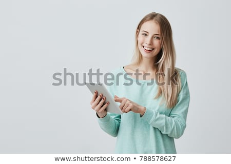 Cute student holding tablet computer. stock photo © lithian