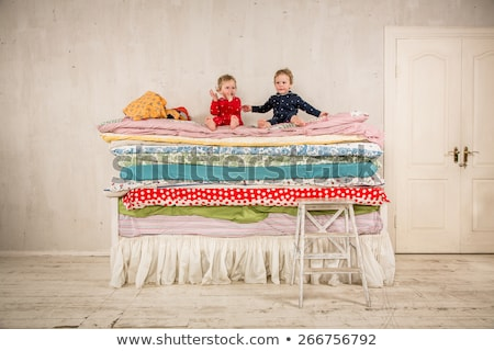 Child climbs on the bed - Princess and the Pea. Stock photo © cookelma