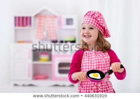 Pişirmek rol sevimli küçük kız Stok fotoğraf © Aikon