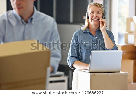 Female Manager Using Headset In Distribution Warehouse Stock photo © monkey_business