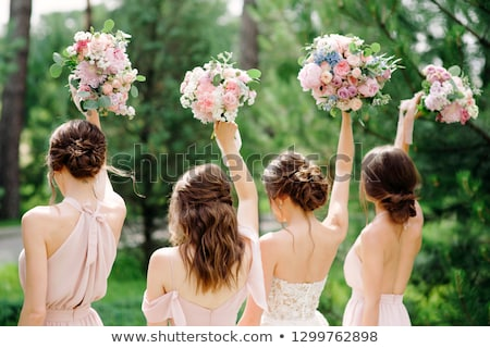 beautiful young bride with luxury bouquet of blue roses stock photo © nejron