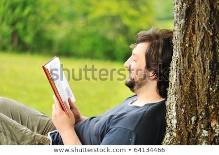 Férfi könyv mező jóképű férfi tanul kint Stock fotó © justinb