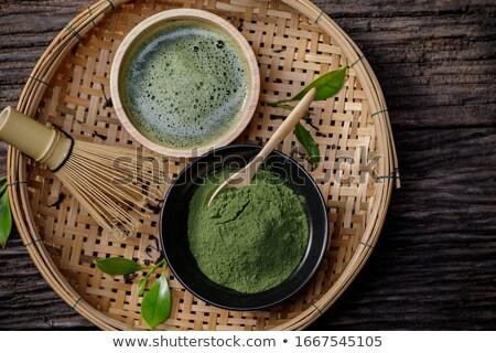 Kéz forró zöld tea üveg víz háttér Stock fotó © nalinratphi
