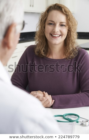 Plus Size Woman In Meeting With Dietitian Stock photo © HighwayStarz
