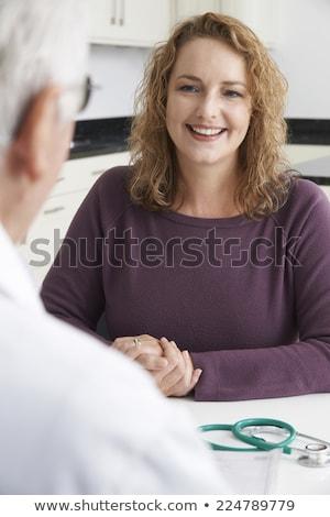Плюс размер женщину заседание диетврач человека фрукты Сток-фото © HighwayStarz