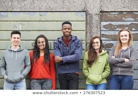 Gang Of Teenagers Hanging Out In Urban Environment Stock photo © HighwayStarz