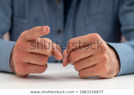 Businessman hits you with a fist Stock photo © deandrobot