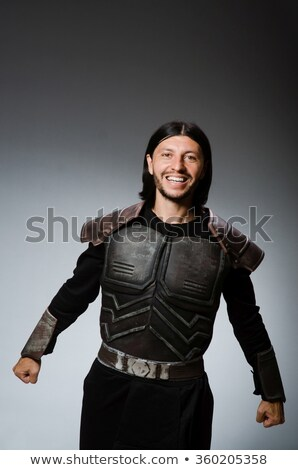 funny knight against dark background stock photo © elnur