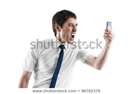 angry businessman yelling on his cell phone over white background stock photo © deandrobot