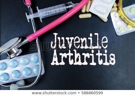 Arthritis - White Word on Red Puzzles. Stock photo © tashatuvango