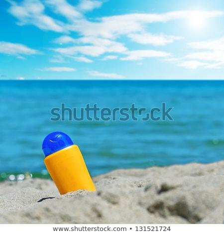 Stockfoto: Zonnebrand · lotion · flessen · zonnige · strand · zand