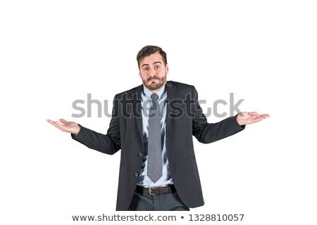 handsome businessman shrugging shoulders stock photo © deandrobot