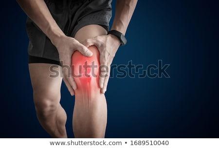 moço · dolorido · joelho · bonito · jovem - foto stock © fouroaks