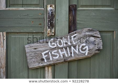Gone Fishing sign at on old door Stock photo © olandsfokus
