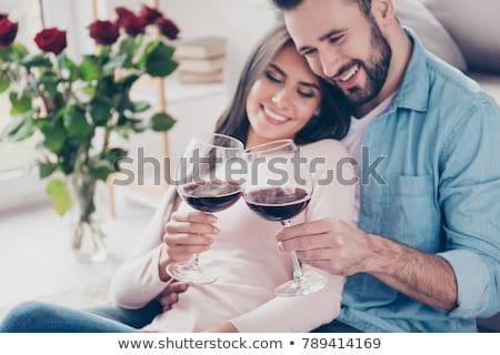 Knuffelen bank rode wijn home woonkamer Stockfoto © wavebreak_media