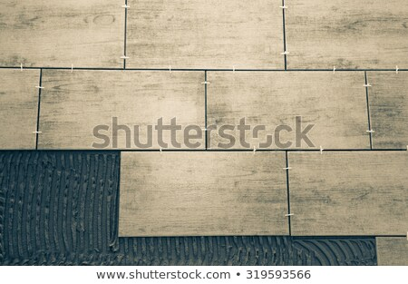 Home renovation, tiles with cross spacers Stock photo © simazoran