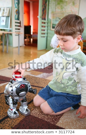 sad child alone with robot in kindergarten Stock photo © Paha_L