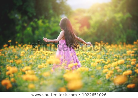 little girl with yellow flower Stock photo © Paha_L