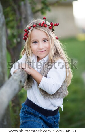 Cheerful pretty woman with wreath of roses stock photo © deandrobot