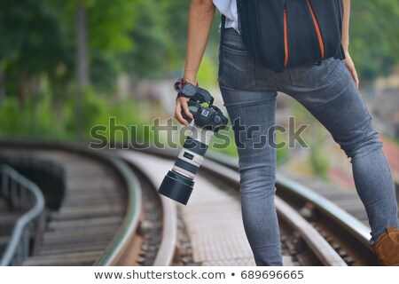 Photographic film holded by young woman photographer  Stock photo © deandrobot