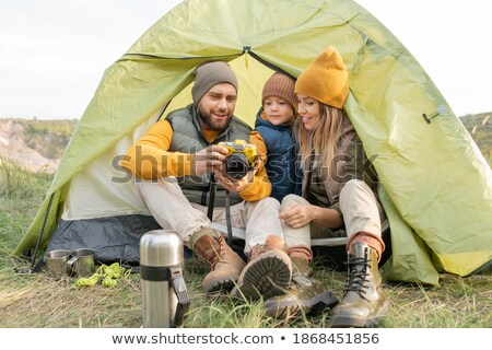 Happy bearded young man with photo camera in winter forest Stock photo © deandrobot