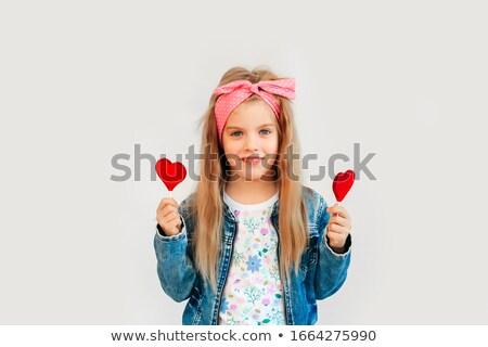 Stylish female teenager eating lollipop Stock photo © deandrobot
