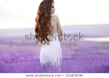 Makeup. Long hair. Beautiful brunette woman with purple flowers, Stock photo © Victoria_Andreas