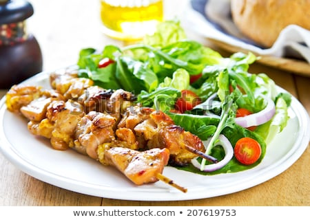 Chicken skewers and salad greens Stock photo © Digifoodstock
