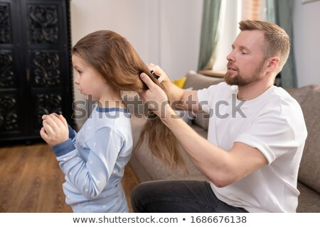 Young woman brushing her long hair Stock photo © dash
