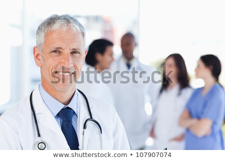 young man smiling and looking upright Stock photo © Giulio_Fornasar
